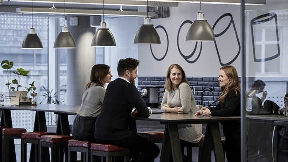 Employees having a conversation in an office