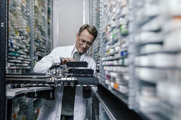 Pharmacist checking the technology of his order picking machine