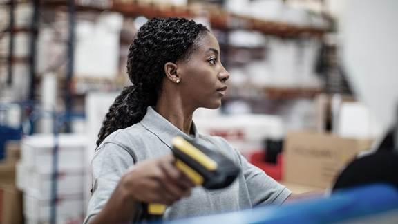 Woman scanning product in a warehouse