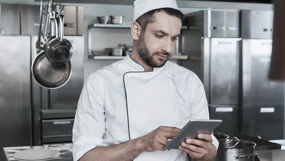 Chef using a tablet