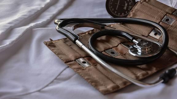 Stethoscope in case on white sheet