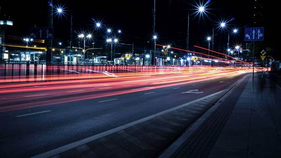 Image of cars lights driving past on a dark evening