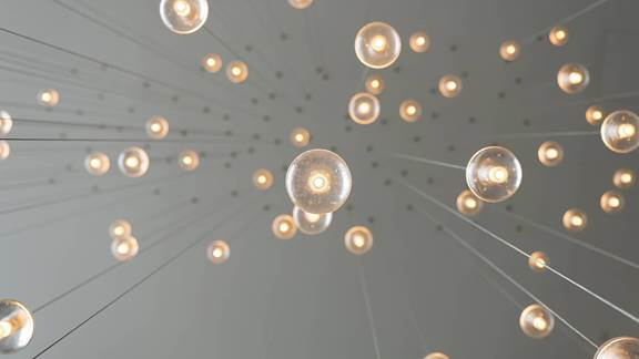 Image of light bulbs hanging from a ceiling
