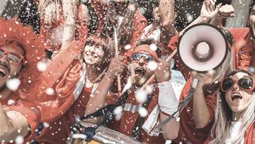 Football supporter at during the World Cup under falling confetti