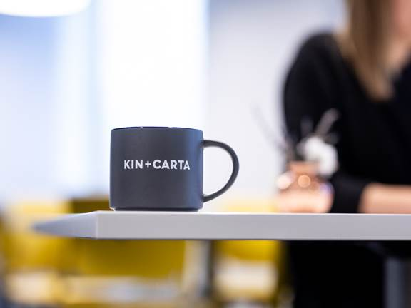 Kin + Carta mug on a desk