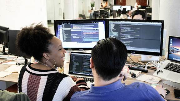 Two people coding