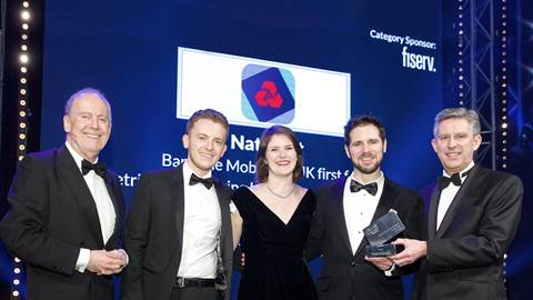 Bankline and Kin and Carta Create team on stage collecting award