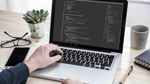 Man programming on a computer