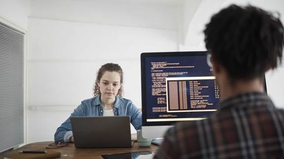 Two Young People Working in Software Development