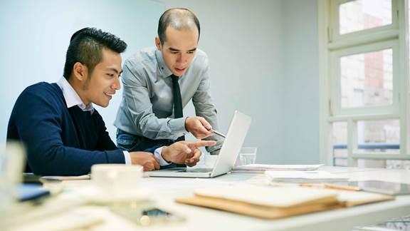 two men analysing information