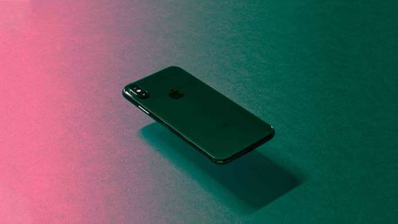 iPhone floating in a minimalistic background