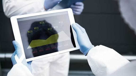 Tablet showing patient evolution statistics