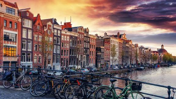 Sunset over Amsterdam canal