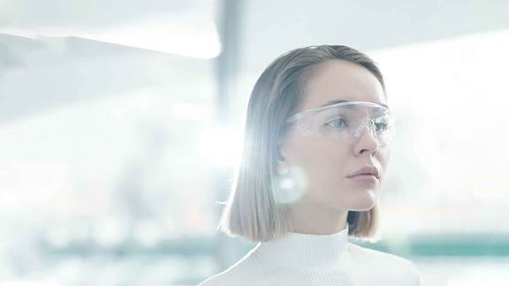 Woman analyzing information with smart glasses