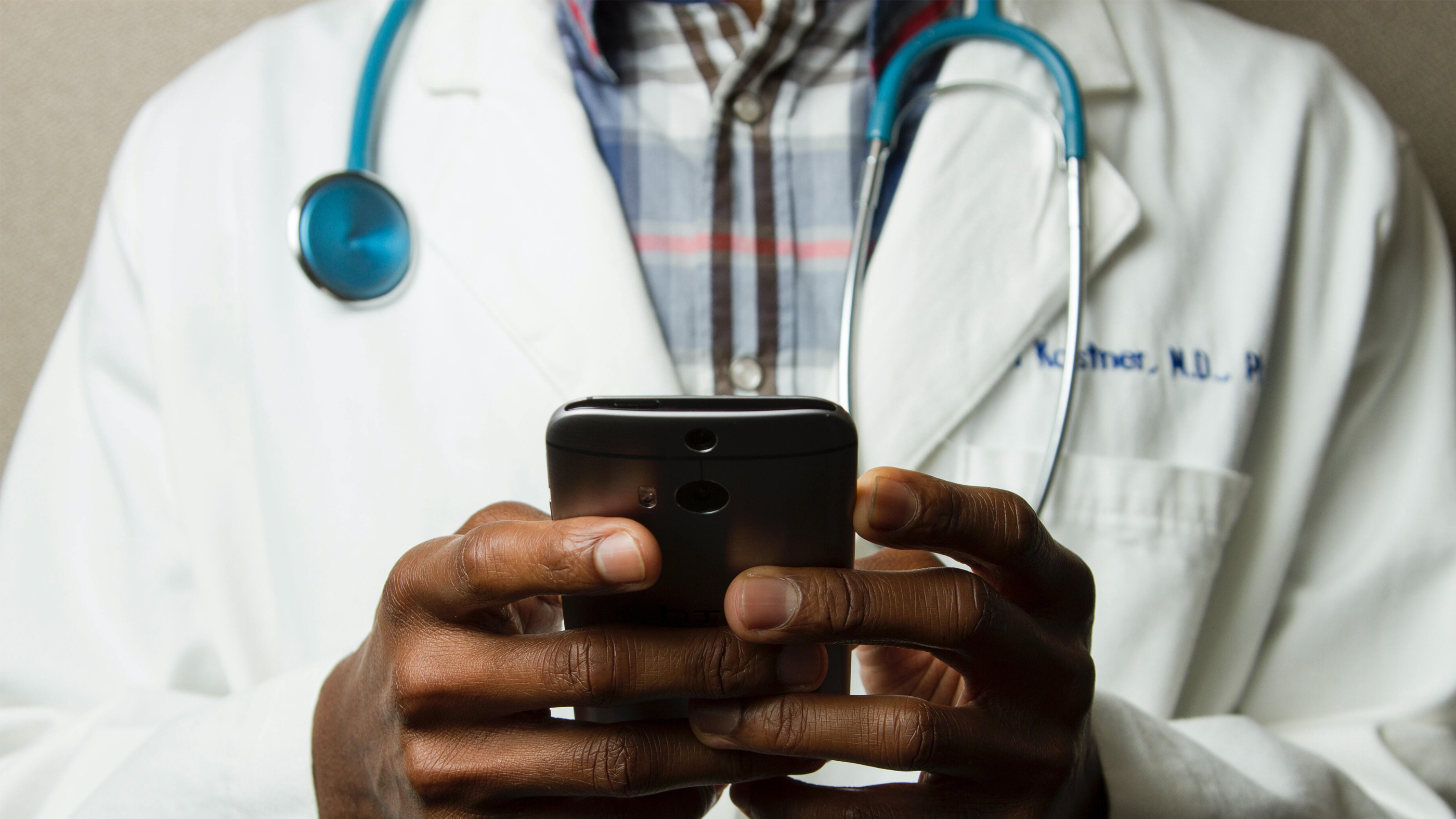 Digital transformation in healthcare doctor on phone