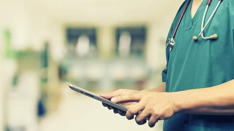 Doctor holding iPad