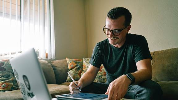 Man playing games on laptop