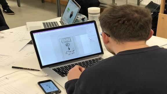Designer working on his laptop