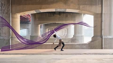 Dancer with purple ribbon