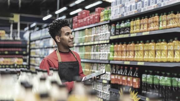 Employee checking stock on shelves