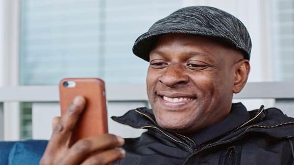 Man smiling at phone