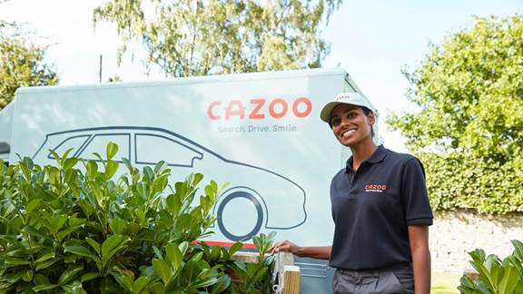 Woman standing in front of Cazoo branded truck