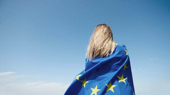 young woman covered with European Union Flag