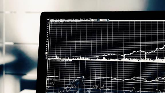 Graph charting upwards on laptop screen
