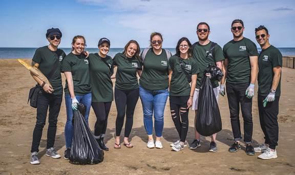 Volunteers collecting garbage at Montrose Beach